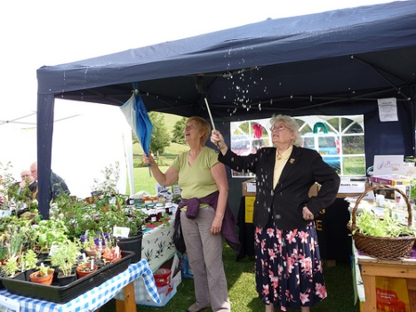 Stall holders tipping rain off a tent at Berry Brow Carnival