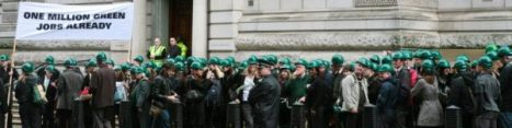 crowd wearing green hard hats outside the Treasury