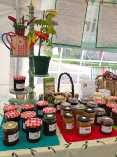 lots of different kinds of jam on a stall